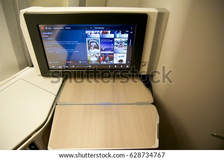 TORONTO, CANADA - JAN 28th, 2017: Air Canada Business class seat with the personal entertainment system huge HD monitor inside a Boeing 777-300ER from AC. Air Canadas 777-300ER business class on this