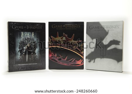 TORONTO, CANADA - JANUARY 28, 2015 : DVD Box Set Collection of HBOs Critically Acclaimed Television Program Game of Thrones shown on a bright background - stock photo