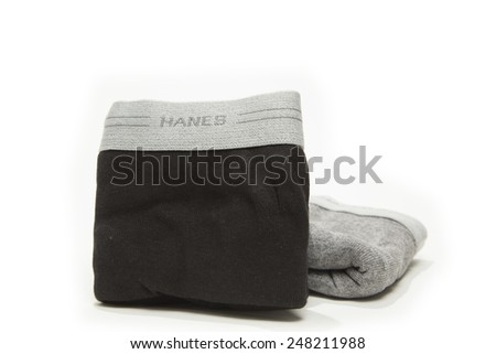Toronto, Canada - January 28 2015 : Pair of Folded Cotton Hane's Brand Men's Boxer Briefs Underwear shown on a bright background - stock photo