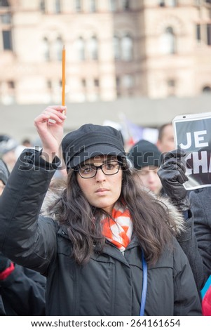 TORONTO,CANADA-JANUARY 11,2015:People meet  in the Je Suis Charlie vigil at Nathan Phillips Square to honor the victims of the Charlie Hebdo magazine shootings and to demonstrate against the terrorism - stock photo