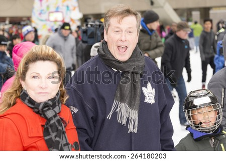 TORONTO,CANADA-JANUARY 1,2015:Toronto Mayor John Tory and wife Barbara Hackett in Nathan Phillips Square where he held skating party and talked to the city inhabitants after taking office in December