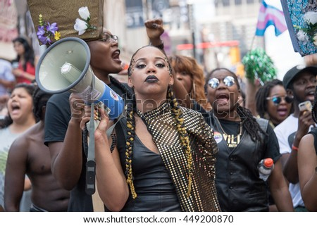 TORONTO,CANADA-JULY 3,2016:Black Lives Matter halts the Toronto Pride Parade staging a sit-in and making demands to Pride Executives. BLM was the honored guest to the celebration
