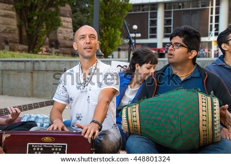 TORONTO,CANADA-JULY 1,2016:Canada Day people: Hare Krishna members playing mantras in front of Old City Hall.Canada Day  is the national day of Canada and a federal statutory holiday. - stock photo