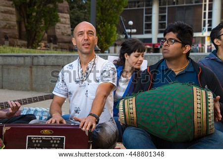 TORONTO,CANADA-JULY 1,2016:Canada Day people: Hare Krishna members playing mantras in front of Old City Hall.Canada Day  is the national day of Canada and a federal statutory holiday - stock photo