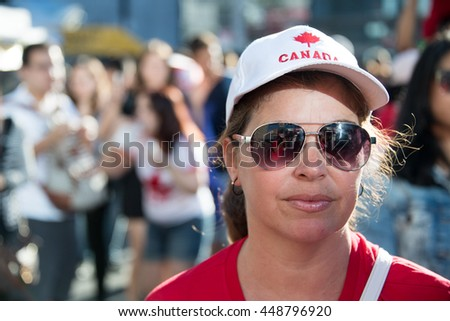 TORONTO,CANADA-JULY 1,2016:Canada Day people: Hispanic woman enjoying the music in Dundas Square..Canada Day  is the national day of Canada and a federal statutory holiday - stock photo