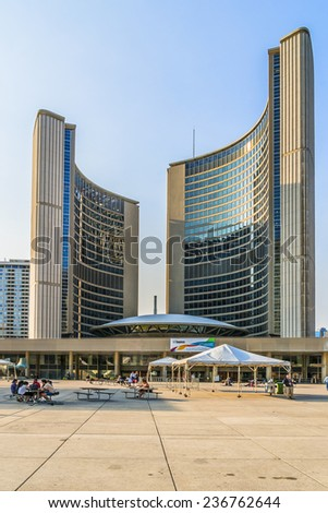TORONTO, CANADA - JULY 23, 2014: City Hall (or New City Hall, by Finnish architect Viljo Revell, 1965) is one of Toronto's best known landmarks. City Hall is home of municipal government of Toronto. - stock photo