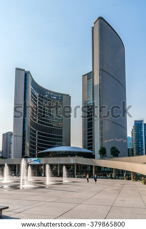 TORONTO, CANADA - JULY 23, 2014: City Hall (or New City Hall, by Finnish architect Viljo Revell, 1965) is one of Toronto's best known landmarks. City Hall is home of municipal government of Toronto.