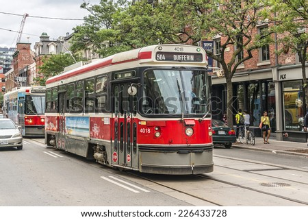 TORONTO, CANADA - JULY 23, 2014: City transportation streetcar. Toronto streetcar system comprises eleven streetcar routes in Toronto, operated by Toronto Transit Commission (TTC). - stock photo