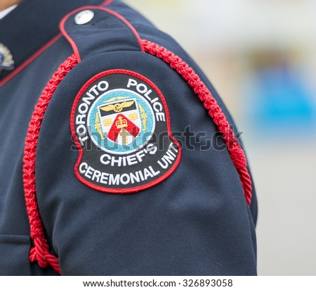 TORONTO,CANADA-JULY 8,2015:Closeup of the badge of Toronto Police - chief's ceremonial unit, worn by a police man at the 2015 Parapan American Games. - stock photo