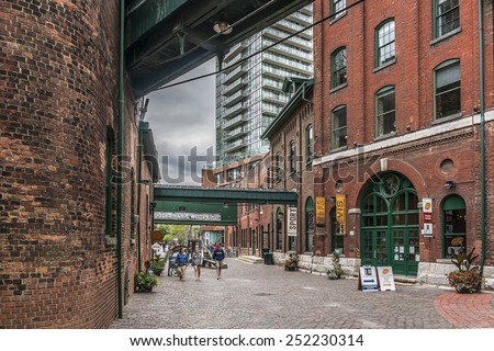 TORONTO, CANADA - JULY 23, 2014: Distillery District (former Gooderham and Worts Distillery) - historic and entertainment precinct. It contains numerous cafes, restaurants and shops. - stock photo