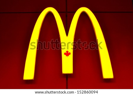 TORONTO, CANADA - JULY 23: McDonald's restaurant sign on July 23, 2013 in downtown Toronto, Ontario, Canada. McDonald's Corporation is the world's largest chain of fast food restaurants. - stock photo