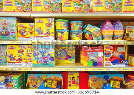 "TORONTO, CANADA - JULY 27, 2015: Play Dough selection at a Toys ""R"" Us store in Toronto, Canada. - stock photo"