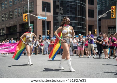 TORONTO,CANADA-JULY 3,2016: 2016 Pride Parade: Drag queens parading.   Torontonians gathered on the street celebrating 36th Pride Parade with the LGBT community.