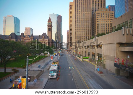 TORONTO,CANADA-JULY 9,2015: Queen street in downtown toronto. Old City Hall building in the background, home to the city council from 1899 to 1966 and one of the city's most prominent structures. - stock photo