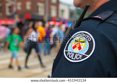 TORONTO,CANADA-JULY  9,2016: Salsa on Saint Clair Avenue West: Toronto Police serving and protecting during the popular event. The festival is the largest of its kind in Canada