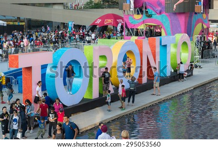 TORONTO,CANADA-JULY 9,2015: The new Toronto sign in Nathan Phillips Square celebrating the PanAm games. Stage have been mounted to held a constant party called Panamania - stock photo