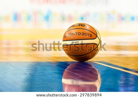 TORONTO,CANADA-JULY 16,2015: Toronto Pan American Games 2015: Official Molten basketball in empty court.  - stock photo