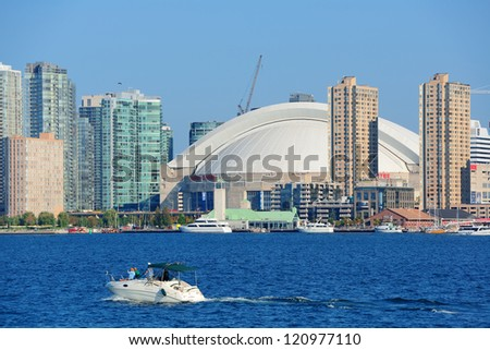 TORONTO, CANADA - JULY 3: Toronto skyline with architectures on July 3, 2012 in Toronto, Canada. Toronto with the population of 6M is the provincial capital of Ontario and the largest city in Canada. - stock photo