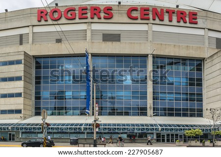 TORONTO, CANADA - JULY 23, 2014: View of Rogers Centre (or SkyDome, opened in 1989). Rogers Centre is a multi-purpose stadium situated next to CN Tower in downtown Toronto, Ontario.