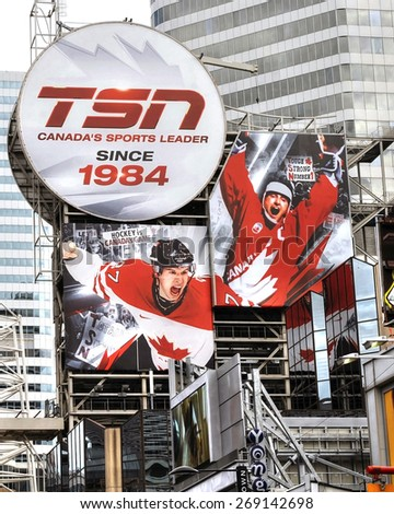 TORONTO, CANADA - Jun 26, 2011:  A huge billboard for TSN (The Sports Network) in Toronto.  TSN was one of the first cable specialty channels in Canada and has been covering sports since 1984.   - stock photo
