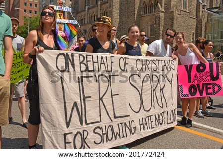 TORONTO, CANADA - JUN 29: Christian WorldPride parade participants hold banner for the final parade June 29, 2014 in Toronto, Ontario. - stock photo