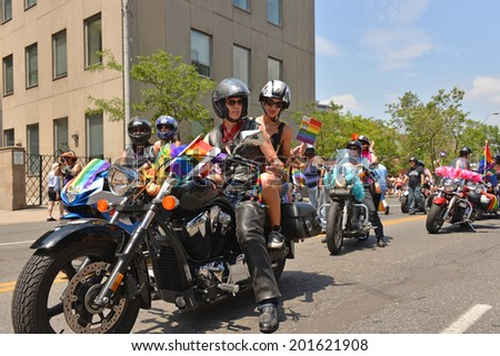 TORONTO, CANADA - JUN 29:  WorldPride participants ride a motorcycle for final parade of the 2014 version of the WorldPride that took place June 20- 29, 2014 in Toronto, Canada - stock photo