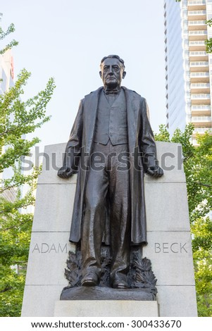 TORONTO,CANADA-JUNE 25,2015: Adam Beck statue, he was a politician and hydroelectricity advocate who founded the Hydro-Electric Power Commission of Ontario. His sculpture was sculpted by Emanuel Hahn - stock photo