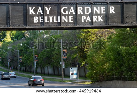 TORONTO,CANADA-JUNE 19,2016:Kay Gardner Beltline Park entrance sign. The Beltline trail is a cycling and walking rail trail in Toronto, mostly enjoyed in spring season.