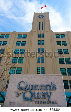 TORONTO,CANADA-JUNE 15,2016: Queen's Quay Terminal building details. Queen's Quay Terminal is a historic building in the city, currently housing condominium apartments and a shopping mall complex.