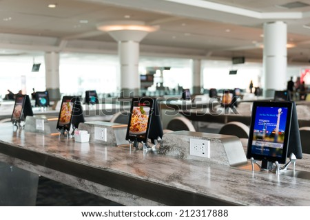 TORONTO,CANADA-JUNE 23,2014: Restaurants are starting to use digital technology for self serving regarding the customer seeing their menu, ordering and paying their bill.  - stock photo