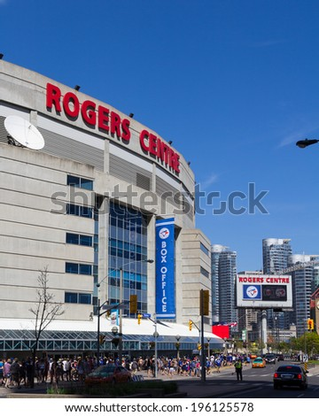 TORONTO, CANADA - JUNE 1, 2014: The outside of the Rogers Centre in Toronto after a game showing large amounts of fans leaving the venue