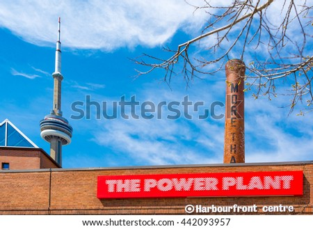 TORONTO,CANADA-JUNE 15,2016:The Power Plant in the harborfront with CN Tower in the background. The building is currently one of Canadas leading public galleries devoted to contemporary art