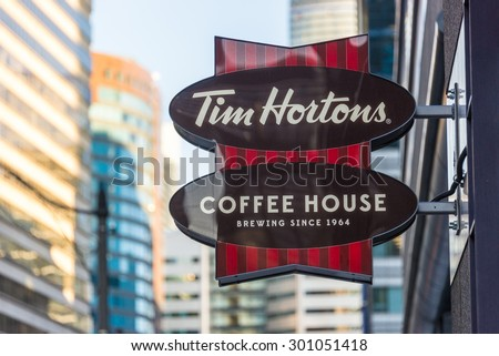 TORONTO,CANADA-JUNE 20,2015: Tim Hortons sign which is a famous restaurant in Canada known for its coffee and doughnuts. It has expand  its operation in other countries  - stock photo