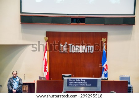 TORONTO,CANADA-JUNE 25,2015: Toronto Council Chamber inside the new city hall, seat of the mayor flanked by the national and provincial flag - stock photo