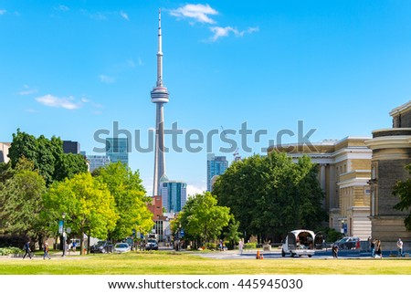 TORONTO,CANADA-JUNE 7,2016: Toronto downtown skyline including tall majestic CN Tower. The Tower is a symbol of Canadian history and a Landmark is visited by locals and tourists around the world.