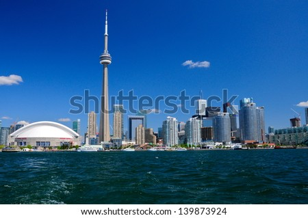 TORONTO, CANADA - JUNE 26: Toronto skyline with architectures on June 26, 2012 in Toronto, Canada.  With a population of 6M, Toronto is the  capital of Ontario and the largest city in Canada. - stock photo
