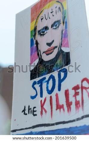 TORONTO, CANADA - JUNE 29:   Toronto  WorldPride Parade, June 29, 2014.  Banner: Putin. Stop the killer. Toronto celebrates 34 years of Pride and the excitement of hosting WorldPride 2014. - stock photo