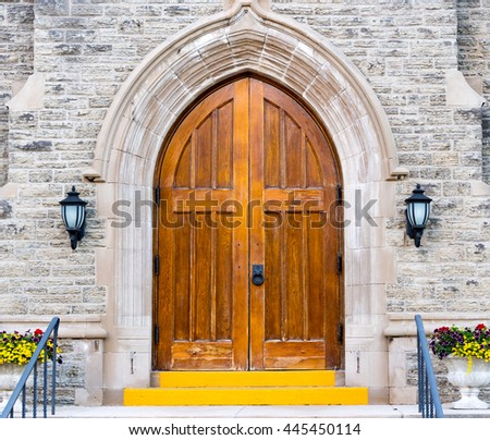 TORONTO,CANADA-JUNE 20,2016: Vintage Anglican Christ Church Deer Park in Yonge Street. Architectural facade with beautiful wooden door. Toronto is known for the mixture of old architectural styles