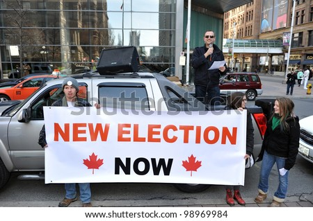 TORONTO, CANADA- MAR 31:  Protesters gathered to protest the election fraud committed in the last Canadian federal election and to call for election reform  Mar 31, 2012 in Toronto, Ontario. - stock photo
