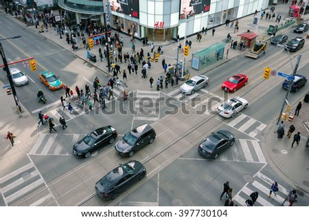TORONTO,CANADA-MARCH 19,2016: Aerial view of Dundas Square and the busiest intersection of the city: Yonge St. and Dundas St. The area is a tourist landmark and a cultural hub of the city - stock photo
