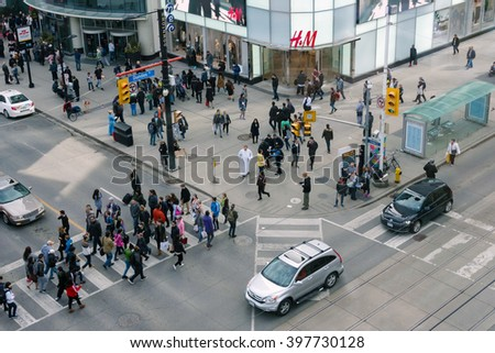 TORONTO,CANADA-MARCH 19,2016: Aerial view of Dundas Square and the busiest intersection of the city: Yonge St. and Dundas St. The area is a tourist landmark and a cultural hub of the city
