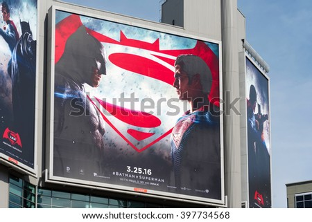 TORONTO,CANADA-MARCH 19,2016: Batman V Superman: Dawn of Justice advertisements in Dundas Square. The film is a 2016 American superhero film  distributed by Warner Bros. Pictures.