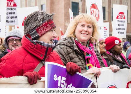 TORONTO,CANADA-MARCH 8,2015:Janet Davis, councillor.Thousands gathered in Toronto to mark International Women Day IWD with a protest march demanding improvements in many social issues. - stock photo