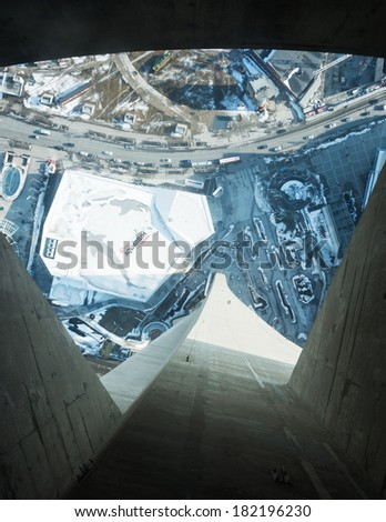 TORONTO,CANADA-MARCH 14, 2014: Looking down from the CN Tower . The Canadian National Tower is one of the highest structures in the world and a tourist landmark  - stock photo