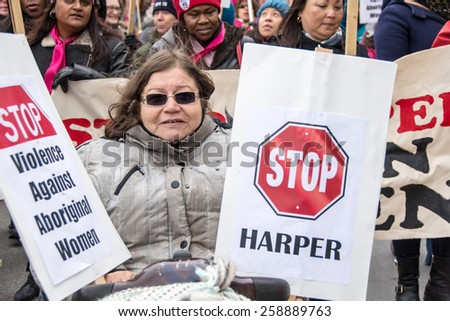 TORONTO,CANADA-MARCH 8,2015: Thousands gathered in Toronto to mark International Women Day IWD with a protest march demanding improvements in many social issues.