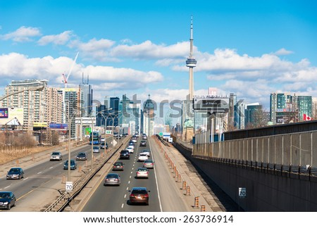 TORONTO,CANADA-MARCH 21,2015: Toronto Skyline featuring the CN Tower. Toronto is the largest, most populous city and the financial capital of Canada - stock photo