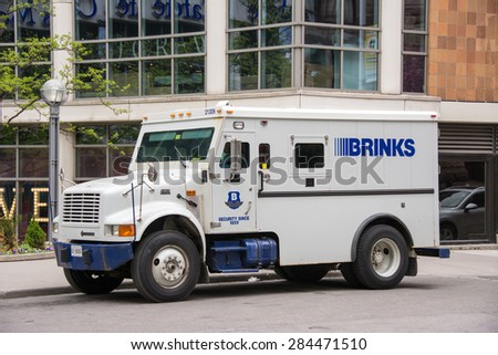 TORONTO,CANADA-MAY 17,2015: Brinks truck in Eaton Centre. The Brink's Company is an American security and protection company headquartered outside of Richmond, Virginia, United States. - stock photo