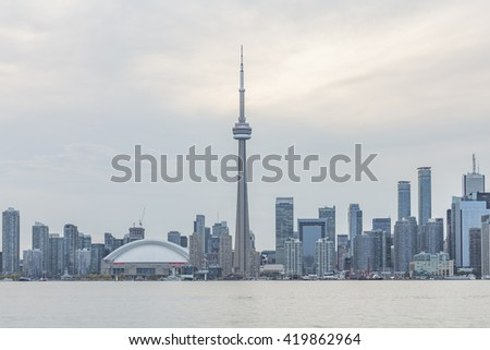 TORONTO, CANADA - MAY 12, 2015: Downtown Toronto skyline with the CN Tower , Rogers Centre and financial district skyskrapers just before rain - stock photo