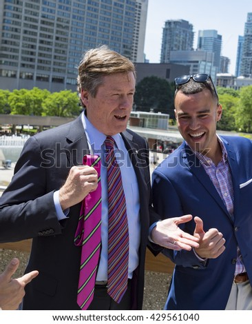 TORONTO,CANADA-MAY 31,2016:John Tory jokes and have fun about the pink tie he was given to wear in the Ottawa's meeting of Mayors. Toronto City successfully launches the first Pride Month in Canada.