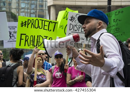 TORONTO,CANADA-MAY 27,2016:Justin Loizoa from the Cannabis Rights Coalition the protest against Project Claudia outside Toronto Police Headquarters.Project Claudia was a crack down on pot dispensaries